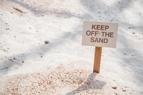 keep-off-sand-sign-stuck-ground-to-people-walking-95258269.jpg