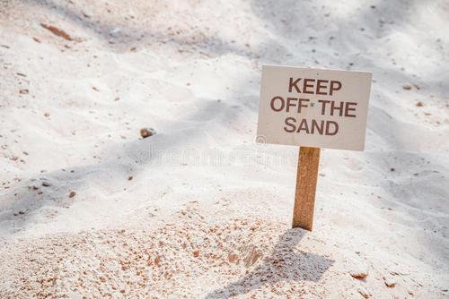 keep-off-sand-sign-stuck-ground-to-people-walking-95258269.jpg